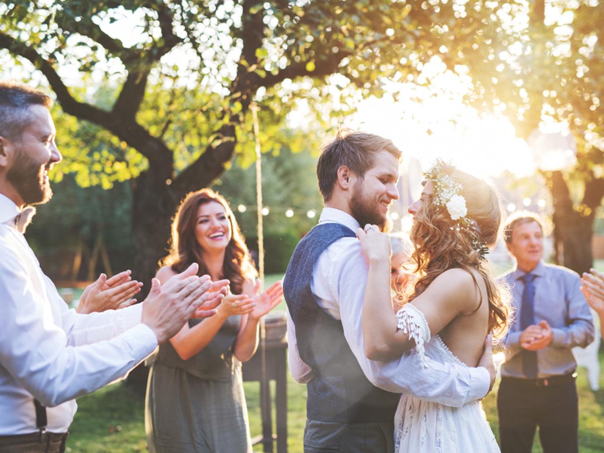 wedding couple dancing outdoors